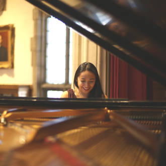 McMaster student playing the piano